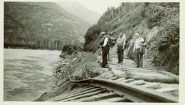 Four men trekking along the CNR line to view the disappearing track along the Skeena River