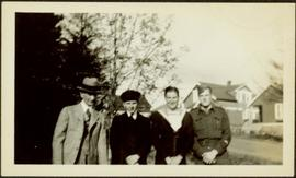 H.F. Glassey with Men in Military Uniforms