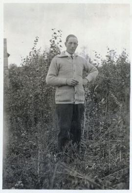 Man wearing a sweater standing in a field