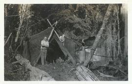 Man standing in front of a tent