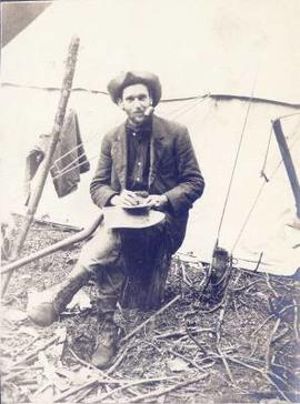 Man eating outside a tent