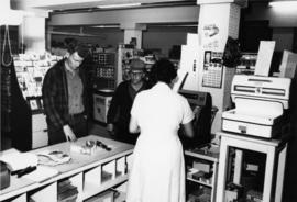 1965 - Unknown Woman & Men in Company Store