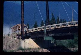 Woods Division - Bridges - Logging truck approaching McGregor River suspension bridge