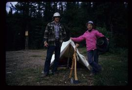 Woods Division - Timbercruising - Two unidentified individuals standing outside small tent