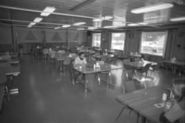 Workplace Album - Man Seated in Dining Room