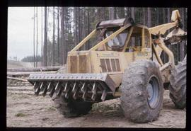 Woods Division - Delimbing - Comb type delimber at B & R operation on 667 skidder