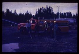 Houston Sawmill - General - New fire truck using hose