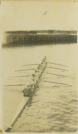 University of Washington rowing team sculling near wharf