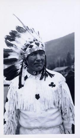 First Nations man in full regalia