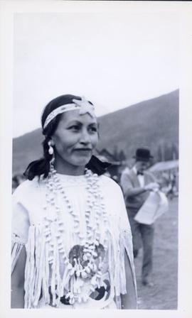 First Nations woman in full regalia