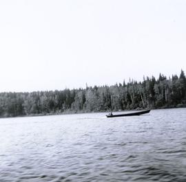 Motorized canoe (?) on Lake Babine