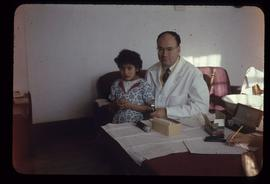 Doctor and a patient sitting behind a desk