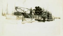Bulldozer freighting in supplies in winter