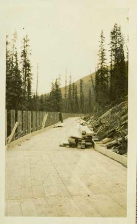 Construction of a wood planked flume 8ft wide around the side of a mountain