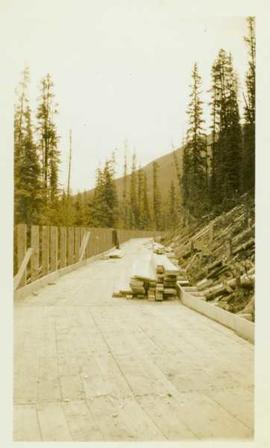 Construction of a wood planked flume 8ft.wide around the side of a mountain