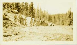 Ditch construction by bulldozer within a forested landscape