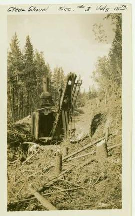 Close up of a steam shovel digging into a hillside