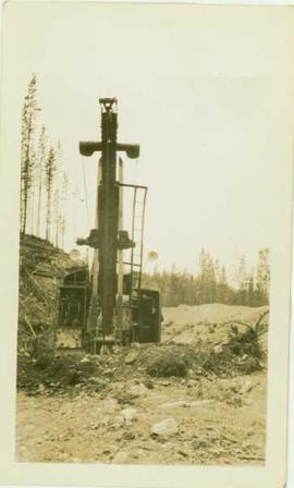 Close up of front end of steam shovel in the field