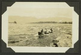 Survey crew and supplies on a canoe on the Finlay Rapids on the Peace River