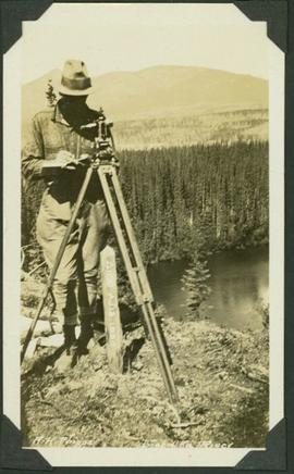 Al Phipps taking measurements at a river station