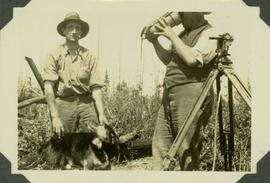 Reading stations with Wild Transit Theodolite. J.R.M. with Frank Swannell quenching thirst from T...
