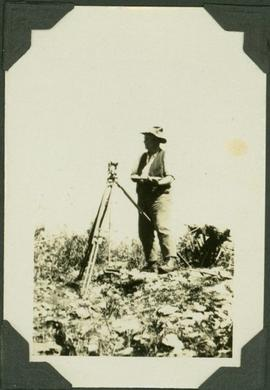 Frank Swannell surveying
