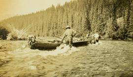 Three survey crewmen pulling the boat through the river