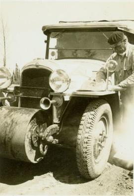 Mr. Balourdet reading a map on the hood of a Citroen half-track