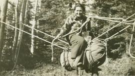"Josephine Daly riding a makeshift ""horse"""