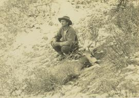 Bruce Otto sits next to a felled mule deer