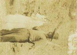 Guide, Bruce Otto (?), holding up large mountain goat shot by Prentiss Gray