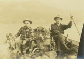 Mac McGarvey (right) and Frank Dewing (left) in a boat on the Peace River