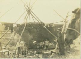 First Nations family at camp on Moberly Lake