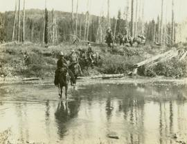 Crew men on horseback fording the South Pine River