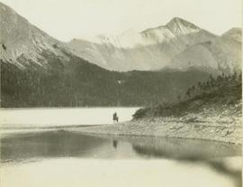 Unidentified Horse and Rider standing on the shore of Moberly Lake