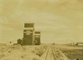 "Dunsdale (silo with sign: ""United Grain Growers Limited, Local No.447"" situated next to..."