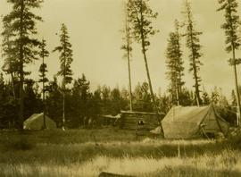 Camp No.3 situated next to a log home