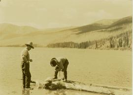 Pete Callao and Johnny Napolean building a raft on Muinok Lake