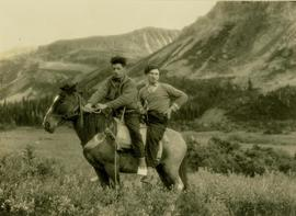 Pete Callao and Billy Taylor on the back of a pack horse