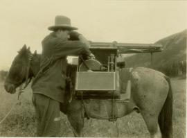 Prentiss Gray loading his camera equipment in a specially designed wooden box