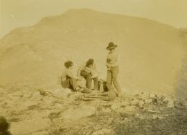 (L-R) Billy Taylor, Johnny Napolean and Pete Callao take a break on a rocky mountain peak