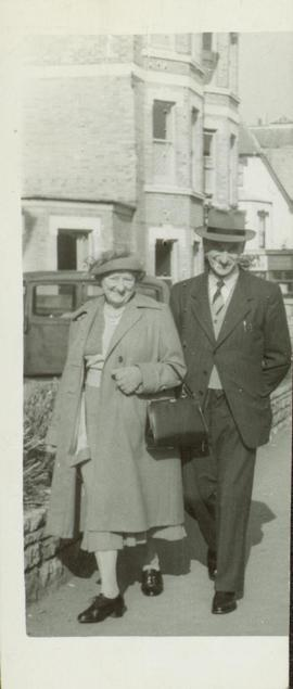 Family photographs from England: Lil & Jim Moore walking arm in arm down the street
