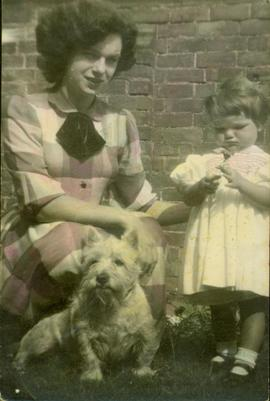 Family photographs from England: Margaret & Marchelle with a terrier dog