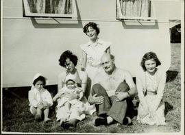 Family photographs from England: Family sitting ouside a trailer