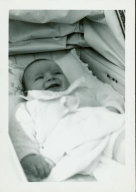 Family photographs from England: Baby John lying in his carriage