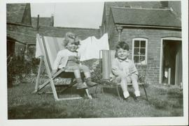 Family photographs from England: John and Christine sitting in lawn chairs