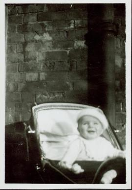 Family photographs from England: Baby John sitting up in his carriage
