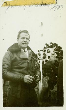 Jimmie Mattern standing next to the propeller of his plane, Prince George