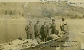 Premier Brewster and the Hon. T.D. Pattullo and party in a boat on the Peace River