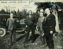 Group photo taken outside featuring Harry Perry, Hon. W. Sutherland, Hon. T.D. Pattullo, and M. Manson